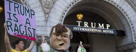 Protesters gather at Trump hotel in Washington on opening day