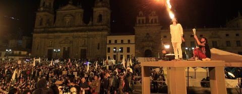 Colombians light torch to symbolize demand for peace