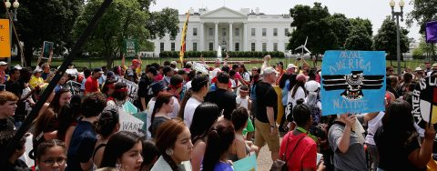 Thousands of pro-climate, anti-Trump protesters march on Washington