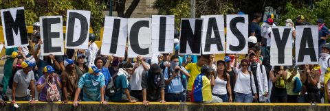 Three people shot during protests in Caracas