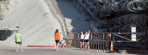 Tourists flock to US-Mexico border to see razor wire